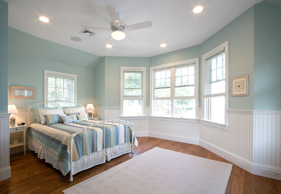 clean cottage bedroom with cool blue walls