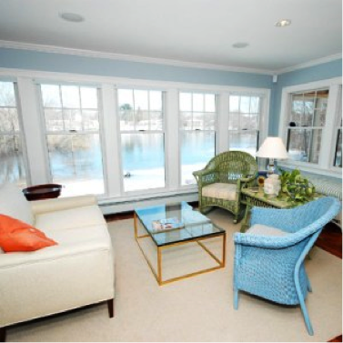 Lightly colored sun room from thisoldhouse.com