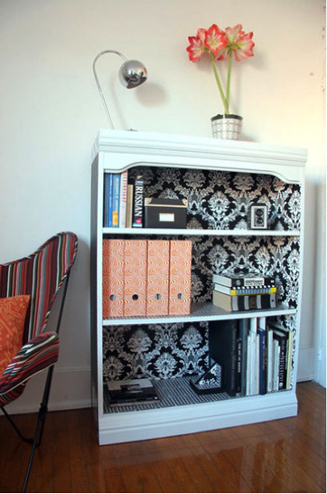 Wallpaper backed bookcase from Apartment Therapy