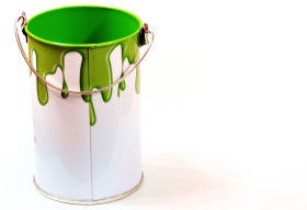 White Paint Can With Green Paint Drips